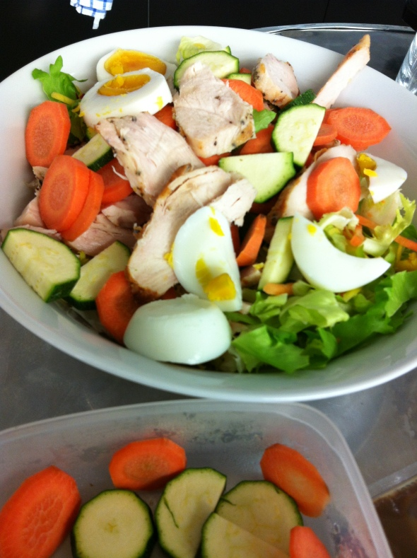 Simple salad bowl with zucchini, carrots, roasted chicken, 1 hardboiled egg