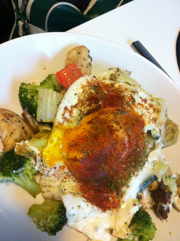 Roasted veggies and chicken in coconut oil topped with egg sunny-side-up