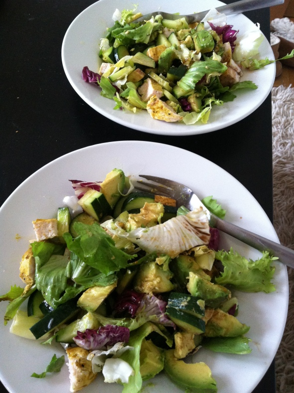 salad greens, roasted curry chicken, avocado, cucumber