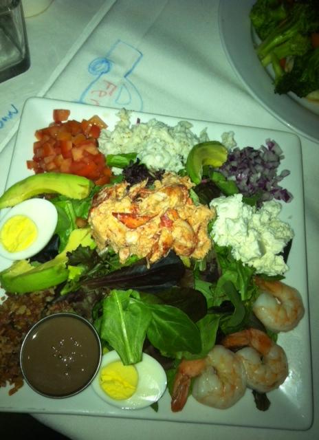 Greens topped with Crabmeat, Lobster, Feta, Avocado, hardboiled egg, Shrimps and random veggies