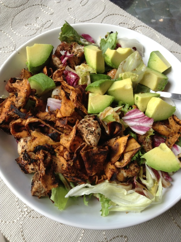Salad topped with Sweet Potato Ribbons by Laura, roasted turkey breast, avocado