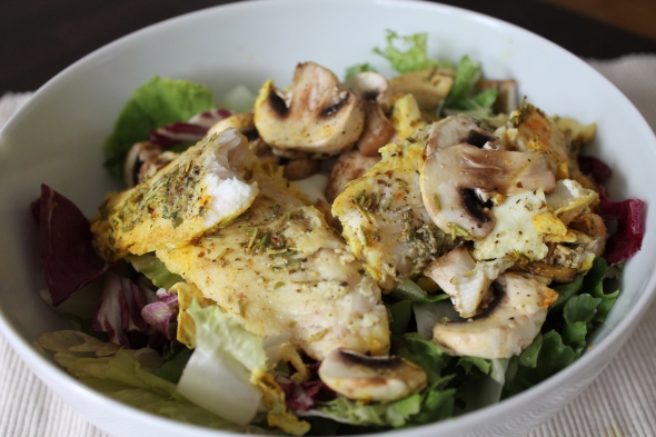 Roasted Catfish with sauteed mushrooms on mixed salad greens