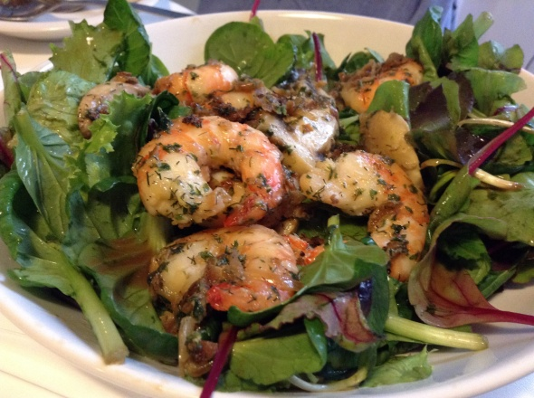 Salad greens with roasted giant prawns, mushrooms and onions