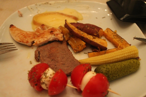 My plate: melted raclette cheese, homemeade sweet potato fries, pickles, baby tomato/mozzarella sticks, beef