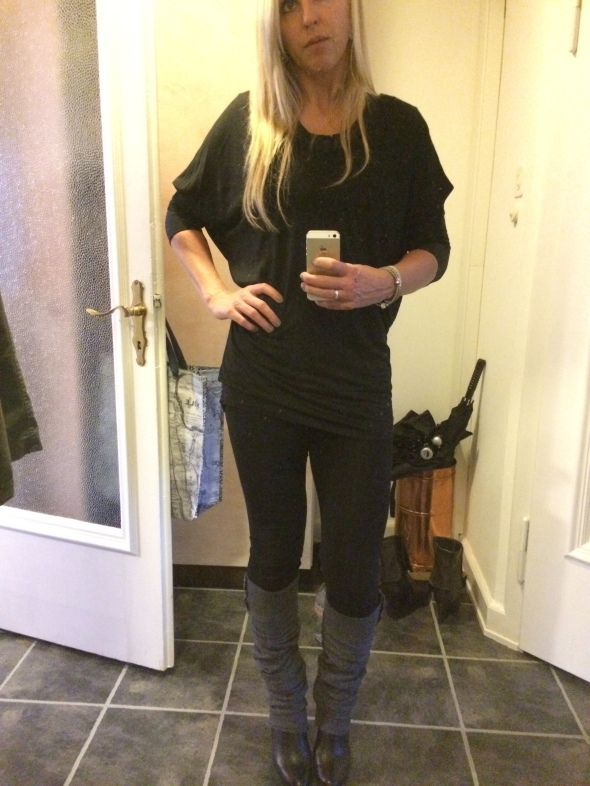 Black tights, leg warmers, heel boots, long black shirt